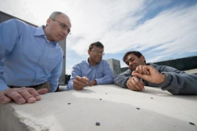 Rigoberto Burgueno and Subir Biswas, MSU engineering professors, and Shantanu Chakrabartty, a professor at Washington University at St. Louis, are developing self-powered sensors that can detect structural defects in buildings and bridges before they occur. The tiny microchips will use sensor-network technology to detect and diagnose potential problems. Photo by G.L. Kohuth.