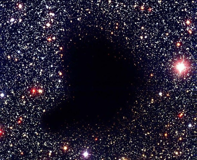 Barnard 68 is a large molecular cloud that is so thick, it blocks out the light from stars that we normally would be able to see.  Credit: ESO