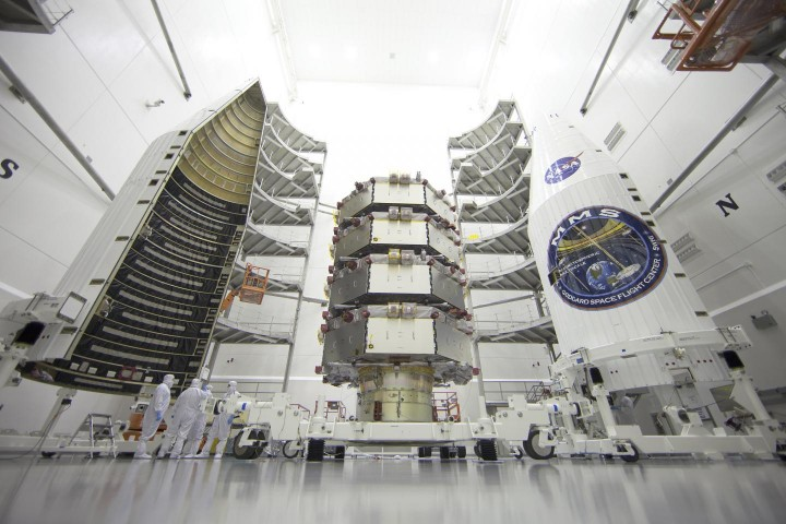 The four MMS observatories are processed for launch in a clean room at the Astrotech Space Operations facility in Titusville, Florida. The MMS mission launched March 12, 2015. Credits: Ben Smegelsky/NASA