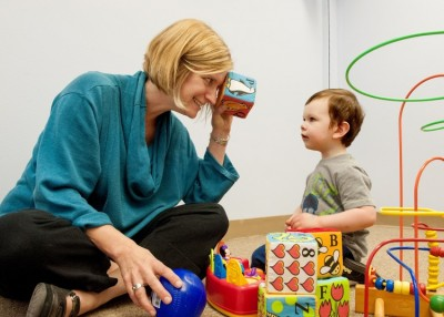 Annette Estes, left, plays with 2-year-old Caellum Ortiz at the UW Autism Center. Image credit: Kathryn Sauber