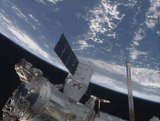 Success! @SpaceX #Dragon is attached to deliver 2 tons of science & supplies for @Space_Station crew. #ISScargo