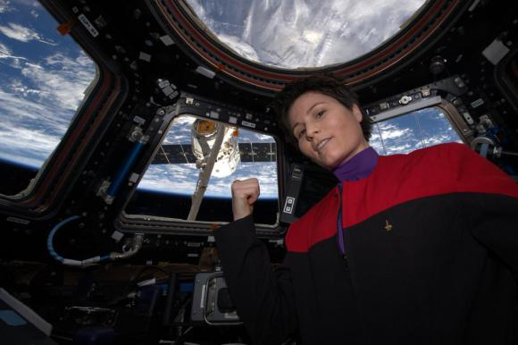 """""""There's coffee in that nebula""""… ehm, I mean… in that #Dragon. ISS Flight Engineer Samantha Cristoforetti of the European Space Agency in Star Trek uniform as Dragon arrives at the International Space Station on April 17, 2015. Credit: NASA"""