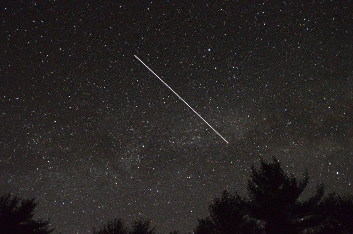 The International Space Station crosses the plane of the Milky Way galaxy. Image credit: David Dickinson
