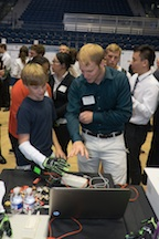 Engineering student Kevin Gravesmill demonstrates the Hands Omni glove created at Rice University for virtual reality gaming systems at the annual Engineering Design Showcase. Image credit: Jeff Fitlow/Rice University