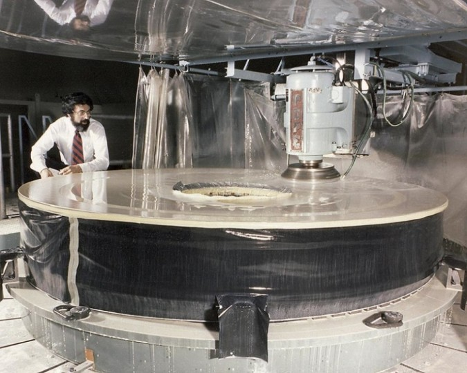 The Hubble Space Telescope's (HST's) Primary Mirror being ground at the Perkin-Elmer Corporation's large optics fabrication facility. Image credit: NASA Marshall Space Flight Center