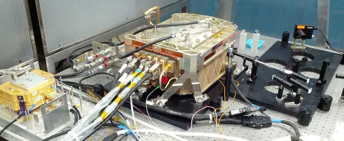 The completed ADM-Aeolus laser under testing at Selex-ES. Despite a number of setbacks, this cutting-edge piece of technology is now ready to be integrated into the rest of the satellite's instrument – a Doppler wind lidar called Aladin. Copyright Selex-ES
