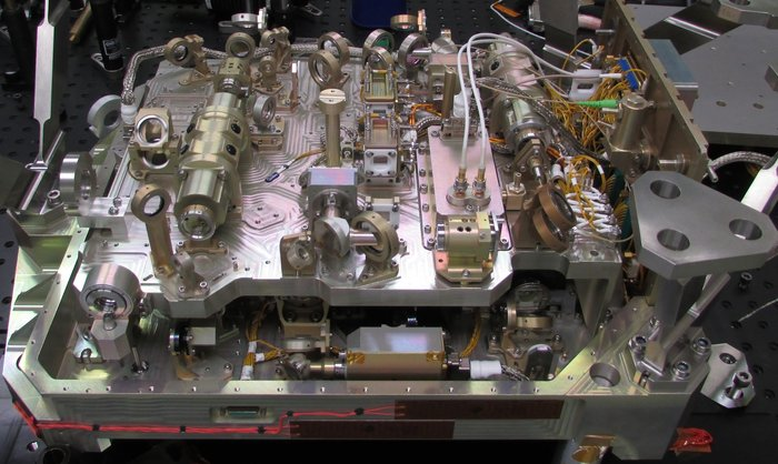 The ADM-Aeolus satellite's second Aladin laser prior to closure showing the complexity of the 80 optical components contained within a relatively small space of 45 x 34 x 20 cm, about the size of a large shoe-box, and weighing around 30 kg. The mission will provide profiles of the world's winds as well as information on aerosols and clouds. These profiles will not only advance our understanding of atmospheric dynamics, but will also offer much-needed information to improve weather forecasts. Copyright Selex-ES