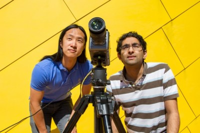 Graduate students Justin Chen and Neal Wadhwa set up a video camera to record the movement of MIT's Green Building. Photo: Jose-Luis Olivares/MIT