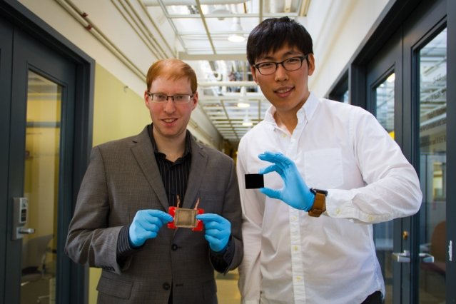 Jeonyoon Lee (right) holds an aligned carbon nanotube array, and Itai Y Stein (left) holds the resulting aligned carbon nanotube film microheater. Photo: Jose-Luis Olivares/MIT