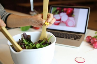 An example scenario of NailO, where it's being used as remote controller for one-handed input, such as scrolling recipes online while cooking. Courtesy of MIT Media Lab