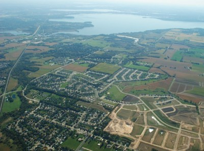 Despite persistent efforts, there has been no improvement in the water quality of Madison lakes. Cleanup efforts are being hampered by more asphalt, row crops and intense rainstorms, according to a new study. Image credit: Eric Booth