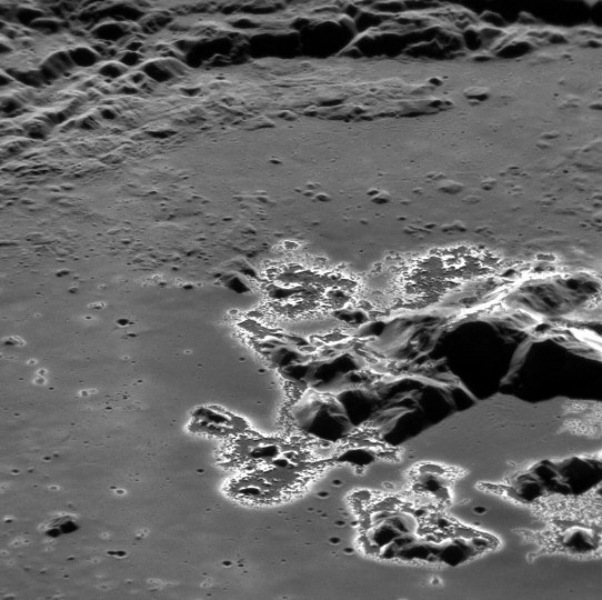 """MESSENGER image of """"hollows"""" around a crater's central peak – one of the many unique discoveries the mission made about Mercury."""
