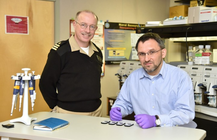 CDR Michael Stockelman and Dr. Tomasz Leski, scientists at the U.S. Naval Research Laboratory, are studying the genetic diversity of the Lassa virus in West Africa. (Photo: U.S. Naval Research Laboratory/Jamie Hartman)