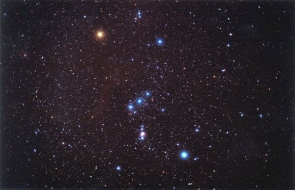 The familiar constellation of Orion. Orion's Belt can be clearly seen, as well as Betelgeuse (red star in the upper left corner) and Rigel (bright blue star in the lower right corner) Credit: NASA Astronomy Picture of the Day Collection NASA