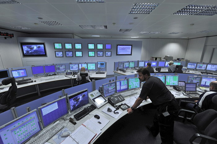 The tracking station control room at the European Space Operations Centre (ESOC) is staffed year-round, 24 hours a day, and provides realtime remote control of all stations in the Agency's worldwide Estrack network. Copyright: ESA/ J. Mai