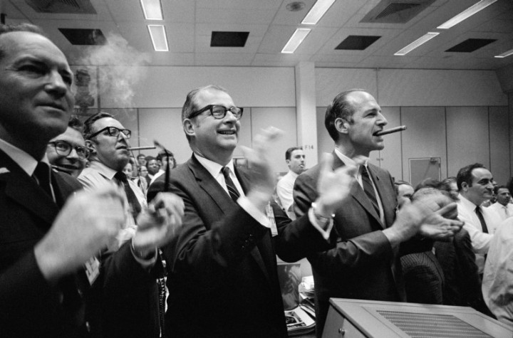 Then-NASA Administrator Thomas Paine (center), together with staff members from NASA Headquarters and the Manned Spacecraft Center, applaud the successful splashdown of the Apollo 13 mission. The splashdown occurred at 12:07 p.m., April 17, 1970, in the south Pacific Ocean. Image Credit: NASA