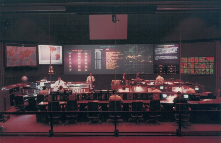 From their key positions in this control center at Goddard, the Manned Space Flight Network operations director and staff controlled Apollo mission communications activities throughout a far-flung worldwide complex of stations. Image Credit: NASA's Goddard Space Flight Center