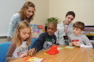 A joint KU and University of Washington randomized trial shows that children with autism can learn how to be social with their peers. The four-year study included children and staff from Prairie Park Elementary in Olathe in 2011. Shown are Amy Akin, paraeducator, and Todd Miller, former KU graduate research assistant.
