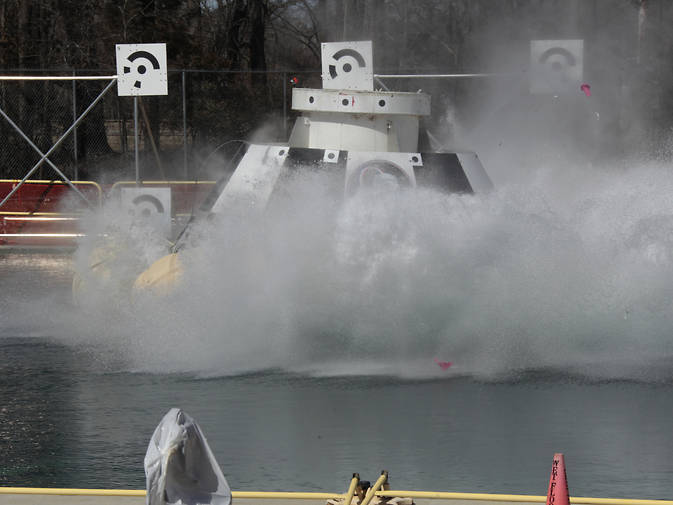 A CST-100 mock up splashes down during a test at NASA's Langley Research Center in Hampton, Va., during tests of the Boeing spacecraft's handling. Image Credit: NASA/Dave Bowman