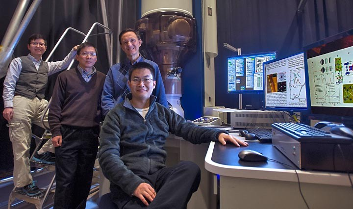 Brookhaven Lab collaborators (from left to right) Jing Tao, Lijun Wu, and Yimei Zhu with MIT student Mingda Li (seated) at the transmission electron microscope used to measure the elusive quantum magnetism.