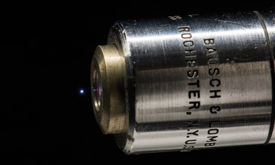A microplasma is created by focusing intense laser pulses in air. Besides visible light, the microplasma emits electromagnetic pulses at terahertz frequencies that can be used to detect complex molecules, such as explosives and drugs. Image credit: J. Adam Fenster / University of Rochester