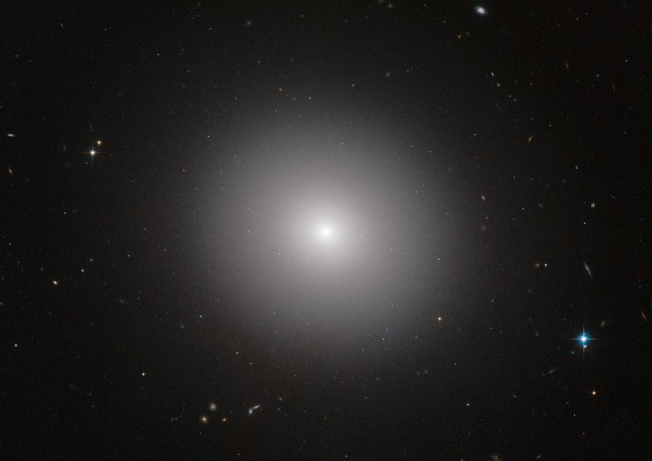 This NASA/ESA Hubble Space Telescope image shows an elliptical galaxy known as IC 2006. Massive elliptical galaxies like these are common in the modern Universe, but how they quenched their once furious rates of star formation is an astrophysical mystery. Now, the NASA/ESA Hubble Space Telescope and ESO's Very Large Telescope (VLT) have revealed that three billion years after the Big Bang, these types of galaxies still made stars on their outskirts, but no longer in their interiors. The quenching of star formation seems to have started in the cores of the galaxies and then spread to the outer parts. Credit: ESA/Hubble & NASA
