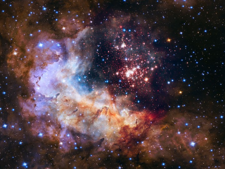 This NASA/ESA Hubble Space Telescope image of the cluster Westerlund 2 and its surroundings has been released to celebrate Hubble's 25th year in orbit and a quarter of a century of new discoveries, stunning images and outstanding science. The image's central region, containing the star cluster, blends visible-light data taken by the Advanced Camera for Surveys and near-infrared exposures taken by the Wide Field Camera 3. The surrounding region is composed of visible-light observations taken by the Advanced Camera for Surveys. Credit: NASA, ESA, the Hubble Heritage Team (STScI/AURA), A. Nota (ESA/STScI), and the Westerlund 2 Science Team