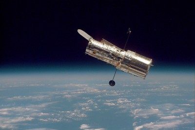 The Hubble Space Telescope hovers at the boundary of Earth and space in this picture, taken after Hubble's second servicing mission in 1997. Image credit: NASA/STScI