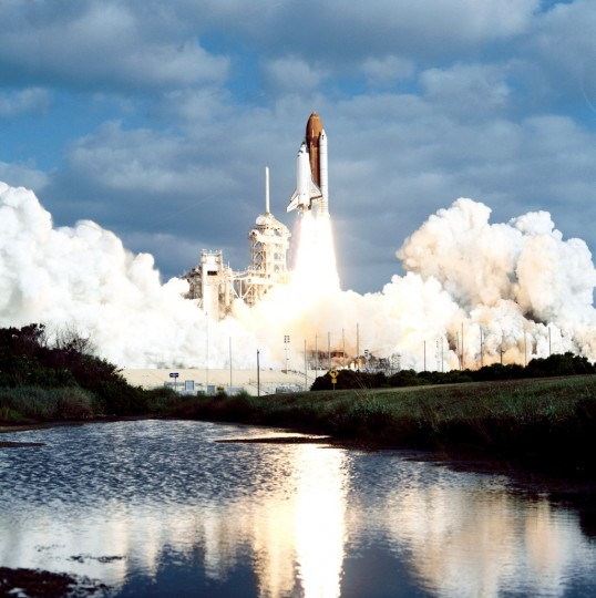 A horizontal view of the launch of the STS-31 mission April 24, 1990. Onboard space shuttle Discovery are the crew of five veteran astronauts and the Hubble Space Telescope. Official launch time was 8:33:51 a.m. EDT. The crew included astronauts Loren Shriver, Charles Bolden Jr., Bruce McCandless, II, Kathryn Sullivan and Steven Hawley. Image Credit: NASA