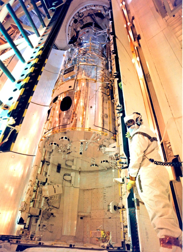 NASA's Hubble Space Telescope is lifted into the vertical position in the Vertical Processing Facility at Kennedy Space Center on Oct. 10, 1989. Image Credit: NASA