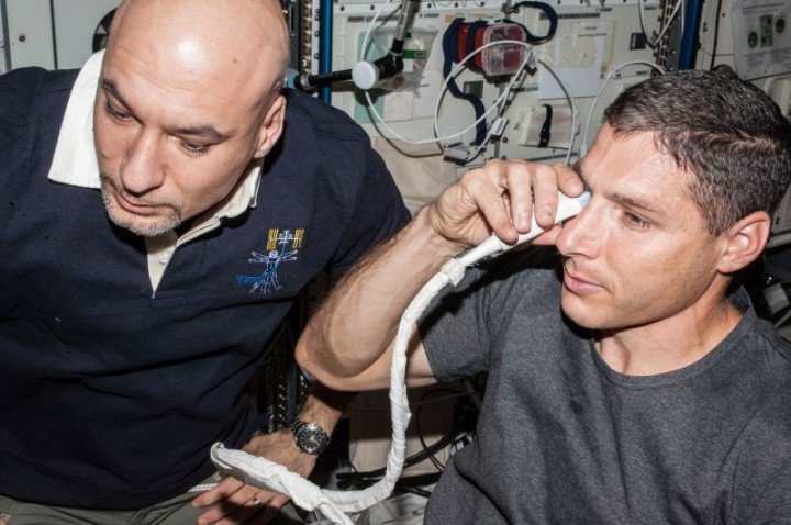 NASA astronaut Michael Hopkins and European Space Agency astronaut Luca Parmitano perform ultrasound eye imaging as part of the Fluid Shifts investigation during Expedition 37 on the International Space Station. Image Credit: NASA