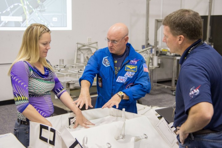NASA astronaut Scott Kelly (center) and NASA astronaut Terry Virts participate in an extravehicular activity (EVA) maintenance training session in the Neutral Buoyancy Laboratory near NASA's Johnson Space Center. Crew instructor Sandra Moore assists Kelly and Virts. Image Credit: NASA/James Blair