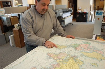 David Knipfer, owner of Mapping Specialists, with one of the company's print-on-demand, large-format maps, which are produced under contract with publishers. Image credit: David Tenenbaum
