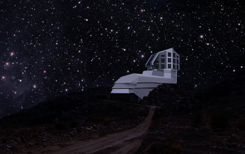 A photograph and a rendering mix, showing a view of the exterior LSST building from the road leading up to the site at night. (March 2011). Image credit: LSST