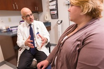 Wajahat Mehal, MD, discusses options for losing weight. Then he tells patients to go home and think about the best options for them. Image credit: Robert A. Lisak