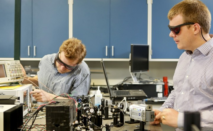 Oak Ridge National Laboratory researchers Raphael Pooser (left) and Benjamin Lawrie have used quantum correlated beams of light to reach unprecedented levels of detection from microcantilever-based sensors.