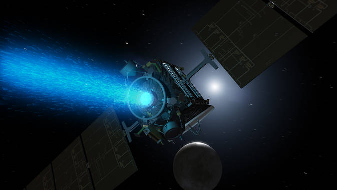 Artist's concept of Dawn above Ceres around the time it was captured into orbit by the dwarf planet in early March. Since its arrival, the spacecraft turned around to point the blue glow of its ion engine in the opposite direction. Image Credit: NASA/JPL-Caltech