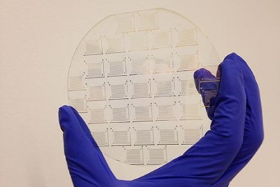 A molybdenum disulphide device array on a transparent silica wafer.