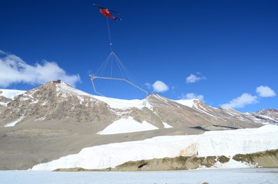 A helicopter flew the airborne electromagnetic mapping (AEM) sensor over Blood Falls and the Taylor Glacier in Antarctica. (Photo by L. Jansan)