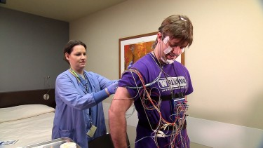 Doctors typically use a polysomnography test – which requires a patient to sleep overnight in a hospital or clinic while hooked up to dozens of sensors – to diagnose sleep apnea today. Image credit: U. of Washington