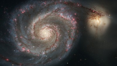 The graceful, winding arms of the majestic Whirlpool Galaxy, as seen from Hubble, appear like a grand spiral staircase sweeping through space. They are actually long lanes of stars and gas laced with dust. Image credit: NASA/STScI