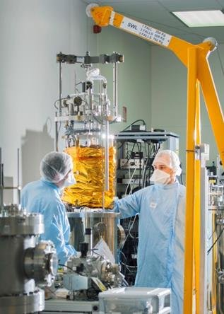 A mechanism being lowered into a vacuum chamber for testing at the European Space Tribology Laboratory. Copyright ESTL