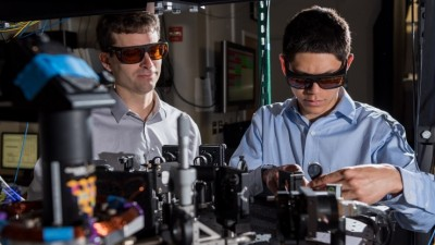Georgia Tech Research Institute (GTRI) scientists work in an optical lab developing improved ion traps that could be used in quantum computing. Shown are (l-r) research scientists Jason Amini and Nicholas Guise. Image credit: Rob Felt