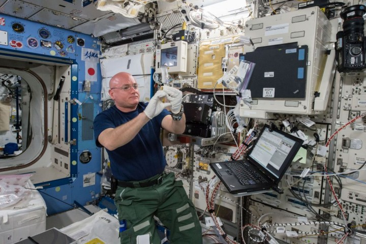 NASA Astronaut Scott Kelly working with the Space Aging investigation and the Cell Biology Experiment Facility rack in the Japanese Experiment Module of the International Space Station. Credits: NASA