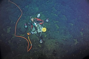 This custom-built precise pressure sensor detects the seafloor's rise and fall as magma, or molten rock, moves in and out of the underlying magma chamber. Three are installed on the caldera of the underwater volcano. Image credit: NSF-OOI/UW/CSSF