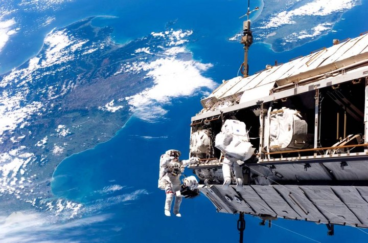 Backdropped by the islands of New Zealand, astronaut Robert Curbeam Jr., left, and European Space Agency astronaut Christer Fuglesang of Sweden, participate in an STS-116 spacewalk on Dec. 12, 2006. The extravehicular activities in support of construction of the International Space Station were crucial in assembly of elements such as the truss segment delivered by the space shuttle Discovery. Credits: NASA
