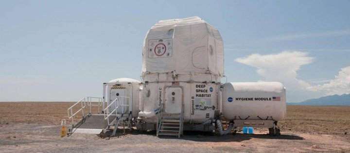 NASA architects, engineers and scientists are already busy creating sustainable, space-based living quarters, work spaces and laboratories for next-generation human term exploration, including our journey to Mars. This 2011 version of the deep space habitat at the Desert Research and Technology Studies (Desert RATS) analog field test site in Arizona features a Habitat Demonstration Unit, with the student-built X-Hab loft on top, a hygiene compartment on one side and airlock on the other. Credits: NASA