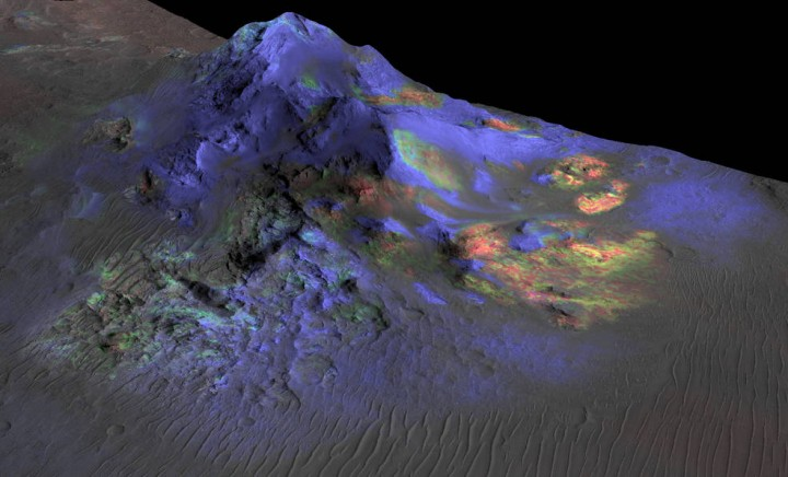 Researchers have found deposits of impact glass (in green) preserved in Martian craters, including Alga Crater, shown here. The detection is based on data from the instrument Compact Reconnaissance Imaging Spectrometer for Mars (CRISM) on NASA's Mars Reconnaissance Orbiter. Credits: NASA/JPL-Caltech/JHUAPL/Univ. of Arizona