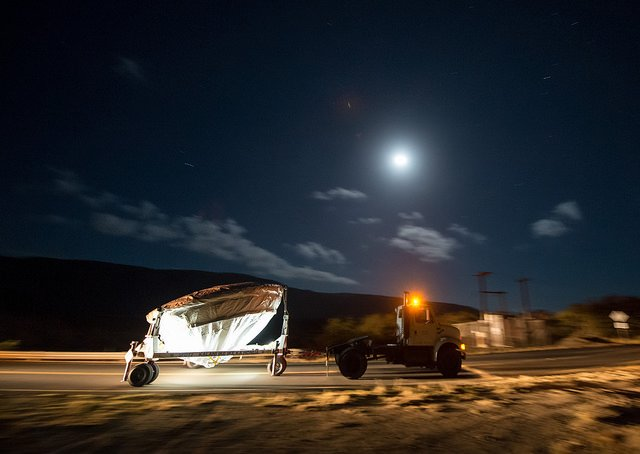 NASA's Low Density Supersonic Decelerator (LDSD) test vehicle is rolled out to the launch pad under moon light, Wednesday, June 3, 2015, at the U.S. Navy Pacific Missile Range Facility (PMRF) in Kauai, Hawaii. The LDSD crosscutting technology demonstration mission will test two breakthrough technologies that will enable larger payloads to be landed safely on the surface of Mars or other planetary bodies with atmospheres, including Earth. Photo Credit: (NASA/Bill Ingalls).