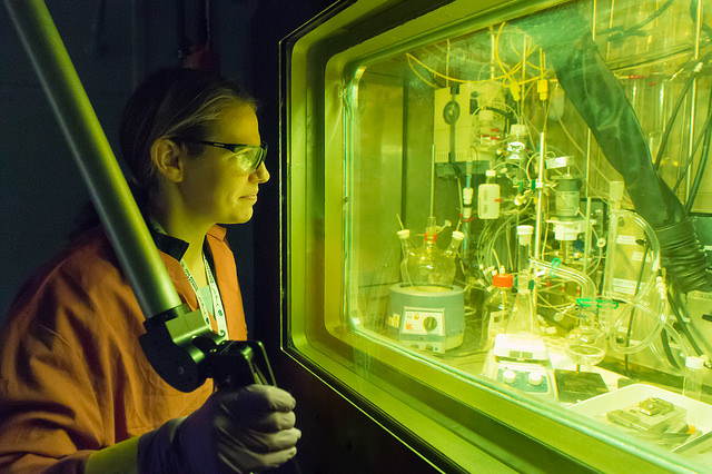 Chemist Amanda Youker operates a remote manipulator arm in a radiation-shielded cell. The cell is used for the purification of molybdenum-99 in a process recently demonstrated by Argonne that could lead to a domestic source of the important medical isotope. Photo by Wes Agresta